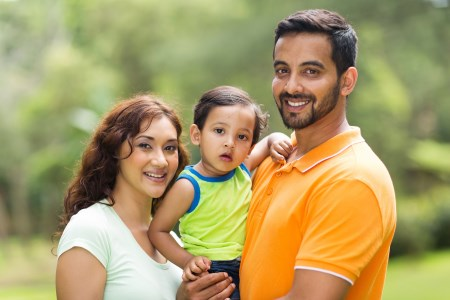 young happy indian family with the kid outdoors